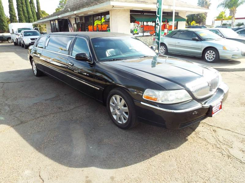 2003 LINCOLN TOWN CAR EXECUTIVE LIMO black this is a 74 inch stretch limo loaded tv in divider dv