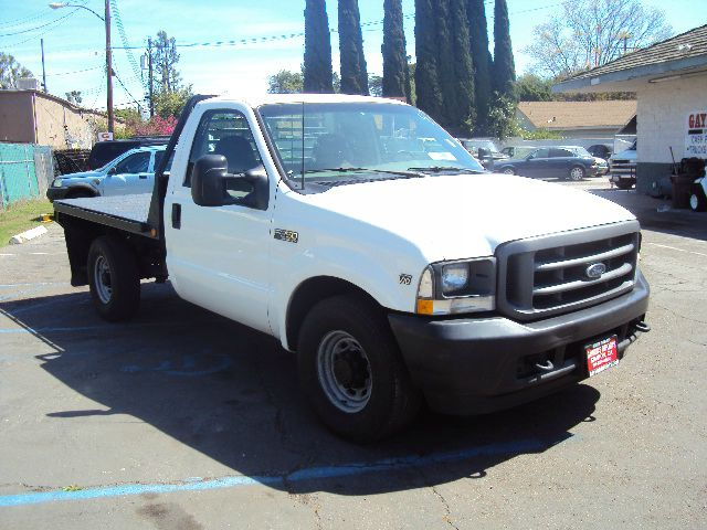2002 FORD F350 XL 2WD white this ford f350 xl  regular cab with a 8 foot steel flat bed automatic