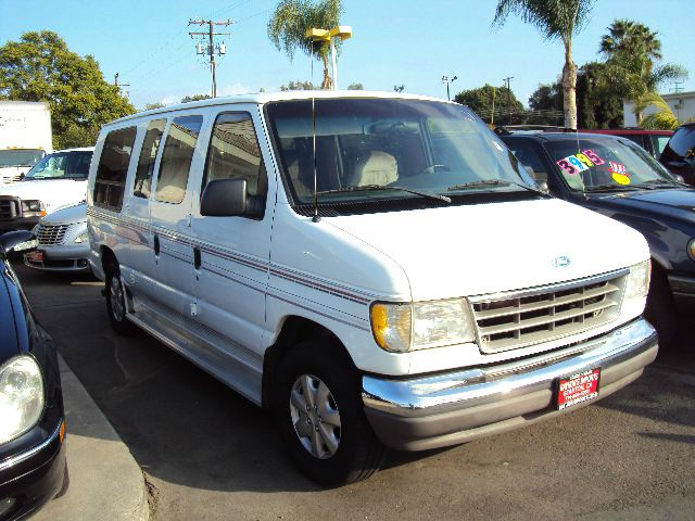 1996 FORD ECONOLINE E150 white this is a low mile van conversion with 4 captain chairs comes with