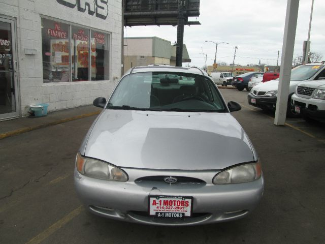 2000 FORD ESCORT BASE 4DR STD SEDAN silver vehicle notes a1 motors llc  4440 w forest home ave  m