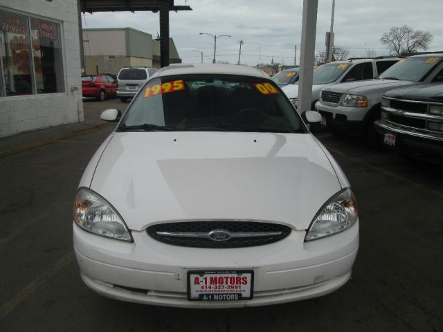 2000 FORD TAURUS SES 4DR SEDAN white vehicle notes a1 motors llc  4440 w fore