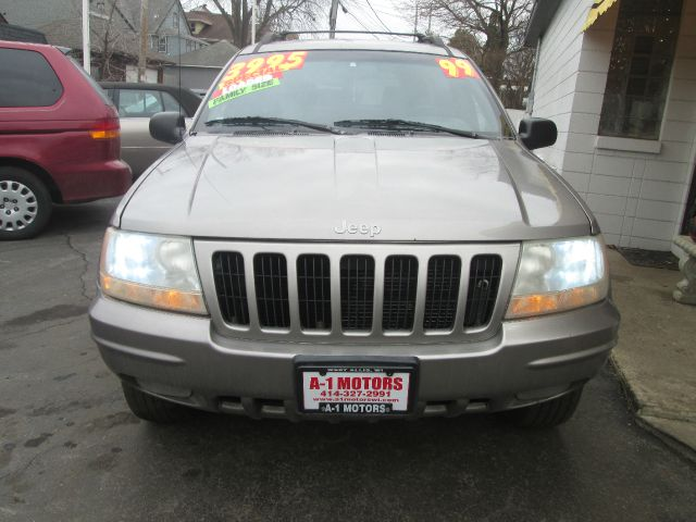 1999 JEEP GRAND CHEROKEE LIMITED 4DR 4WD SUV silver vehicle located at 7623 w