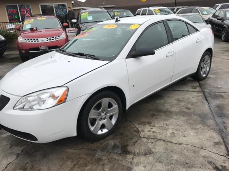 2009 PONTIAC G6 BASE 4DR SEDAN W1SA white this is a beautiful white 2009 pontiac g6 4 door sedan