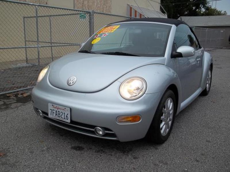 2004 VOLKSWAGEN NEW BEETLE GLS 2DR CONVERTIBLE silver this is a beautiful silver 2004 volkswagen