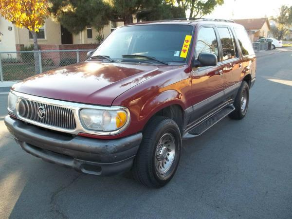 1999 MERCURY MOUNTAINEER BASE 4DR 4WD SUV red this is a beautiful red 1999 mercury mountaineer 4
