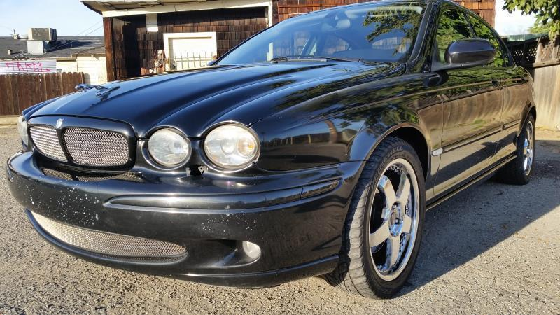 2002 JAGUAR X-TYPE 25 AWD 4DR SEDAN black this is a beautiful black 2002 jaguar x-type 4 door se