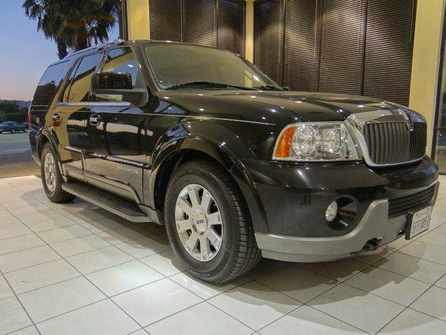2004 LINCOLN NAVIGATOR LUXURY 4WD 4DR SUV black abs - 4-wheel adjustable pedals - power air sus