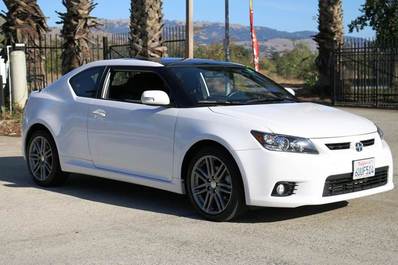 2012 SCION TC BASE 2DR COUPE 6M white 2-stage unlocking doors abs - 4-wheel active head restrai