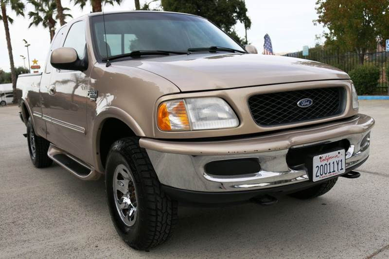 1998 FORD F-250 LARIAT 3DR 4WD EXTENDED CAB SB brown this 1998 ford f250 extended cab is in great
