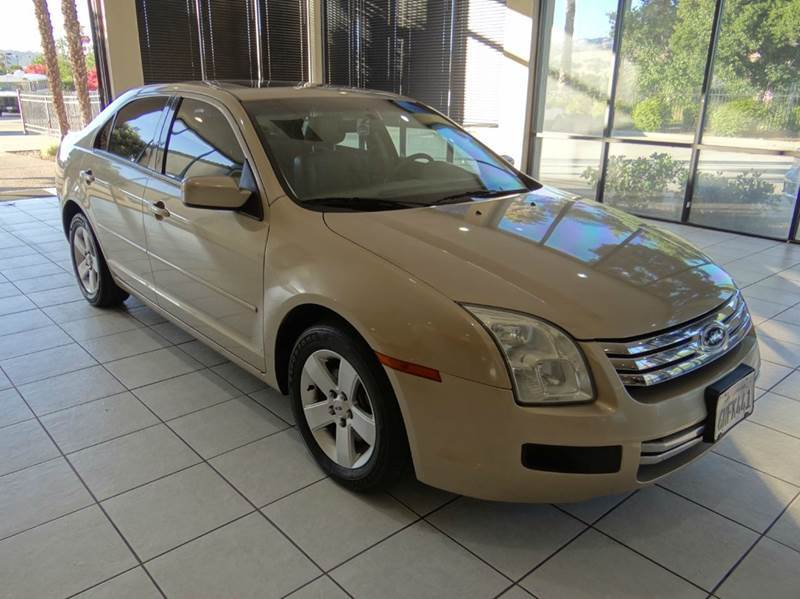 2006 FORD FUSION V6 SE 4DR SEDAN gold airbag deactivation - occupant sensing passenger antenna t