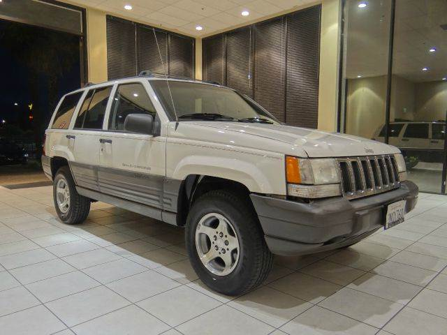 1996 JEEP GRAND CHEROKEE LAREDO 4DR 4WD SUV white abs - 4-wheel cassette center console cruise
