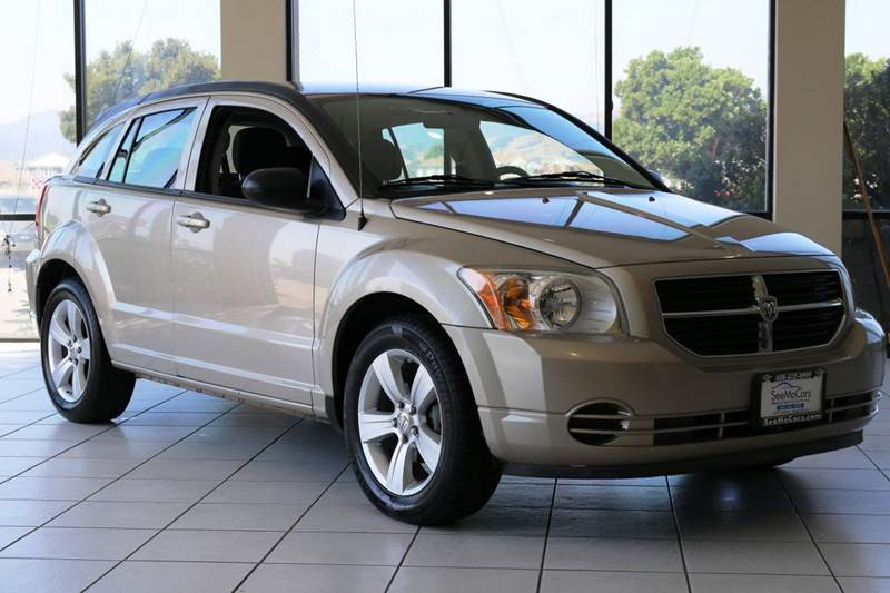 2010 DODGE CALIBER SXT 4DR WAGON tan 2-stage unlocking doors abs - 4-wheel air filtration airb