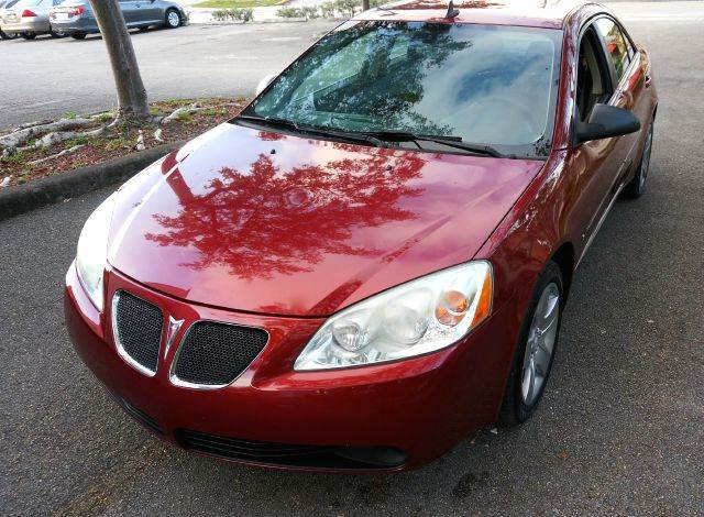 2009 PONTIAC G6 BASE 4DR SEDAN red 2-stage unlocking abs - 4-wheel airbag deactivation - occupa