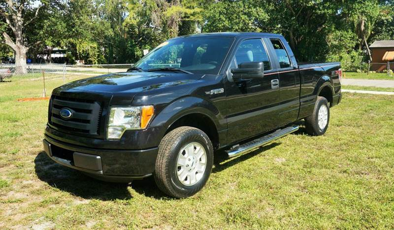 2012 FORD F-150 STX 4X2 4DR SUPERCAB STYLESIDE 6 black 2-stage unlocking abs - 4-wheel airbag d