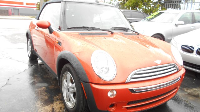 2006 MINI COOPER CONVERTIBLE orange this mini cooper is adorable its so cute you must see it it dr