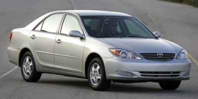 2003 TOYOTA CAMRY LE 4DR SEDAN gold only 95914 miles boasts 33 highway mpg and 23 city mpg thi