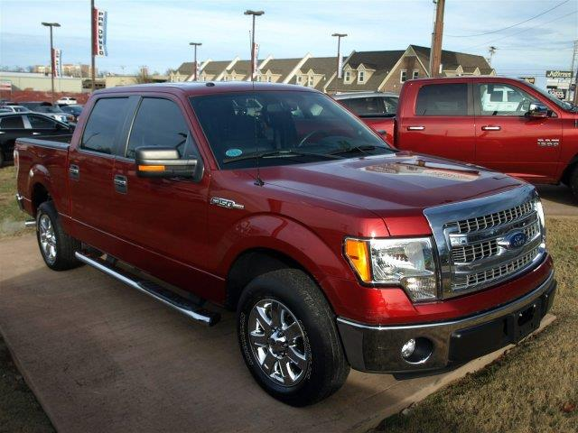 2013 FORD F-150 red only 13889 miles scores 21 highway mpg and 15 city mpg this ford f-150 boa