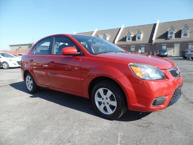 2010 KIA RIO LX 4DR SEDAN 4A red crumple zones front and rearhands-free communication systemabs