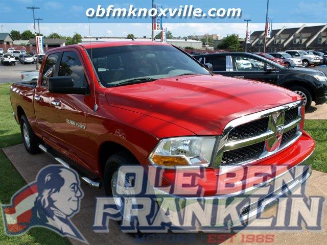 2011 RAM RAM PICKUP 1500 2WD QUAD CAB 1405  SLT red boasts 19 highway mpg and 14 city mpg this