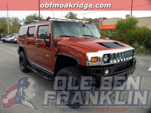 2003 HUMMER H2 sunset orange metallic this hummer h2 delivers a gas v8 60l364 engine powering t