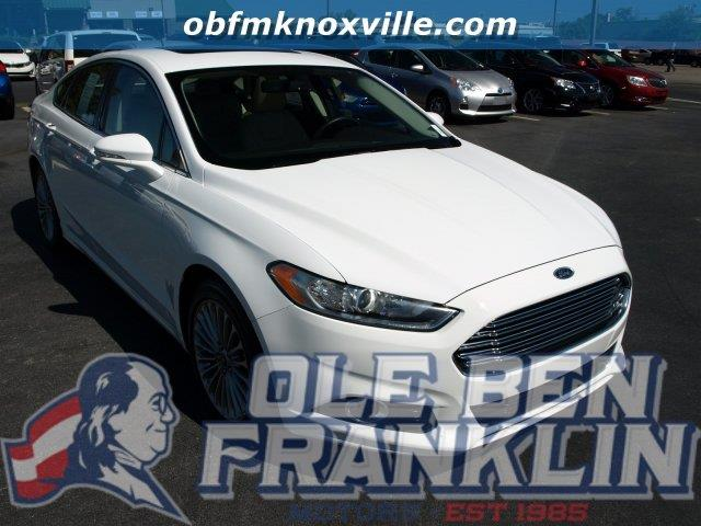 2016 FORD FUSION TITANIUM 4DR SEDAN white only 6722 miles scores 33 highway mpg and 22 city mpg