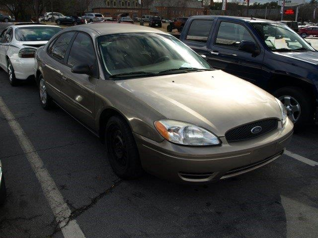 2005 FORD TAURUS SE 4DR SEDAN gold only 114172 miles scores 27 highway mpg and 20 city mpg thi