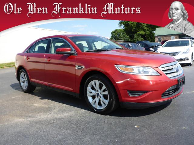 2010 FORD TAURUS SEL 4DR SEDAN candy red metallic tinted delivers 27 highway mpg and 18 city mpg