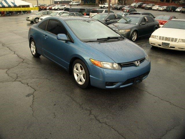 2006 HONDA CIVIC EX 2DR COUPE WAUTOMATIC blue delivers 40 highway mpg and 30 city mpg this hond