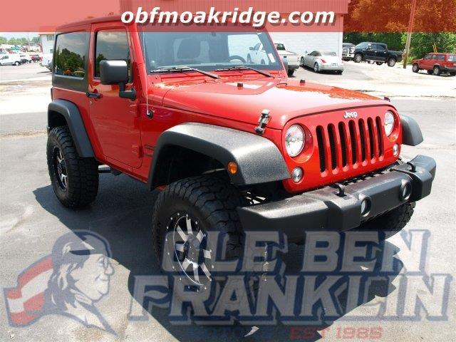 2014 JEEP WRANGLER SPORT 4X4 2DR SUV red this jeep wrangler has a dependable regular unleaded v-6