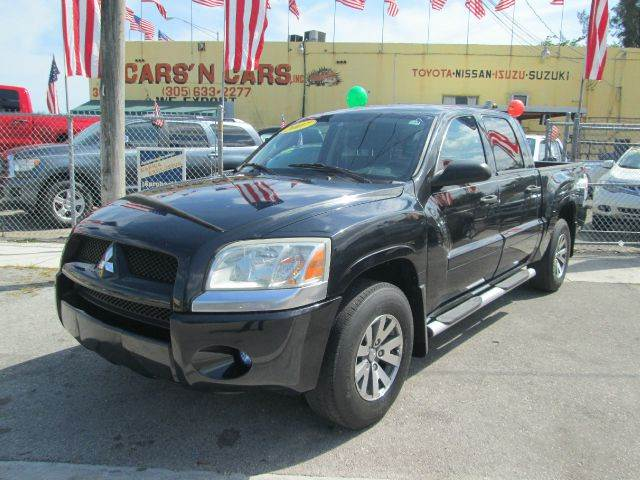 2007 MITSUBISHI RAIDER LS 4DR DOUBLE CAB SB black 2-stage unlocking - remote abs - rear airbag