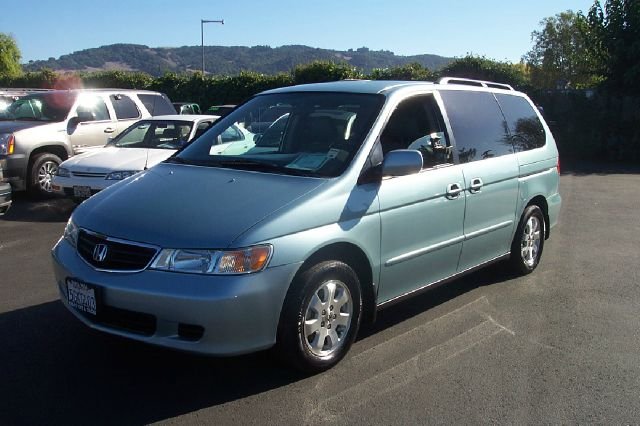 2004 HONDA ODYSSEY EX W LEATHER AND DVD light blue abs brakesair conditioningalloy wheelsamfm