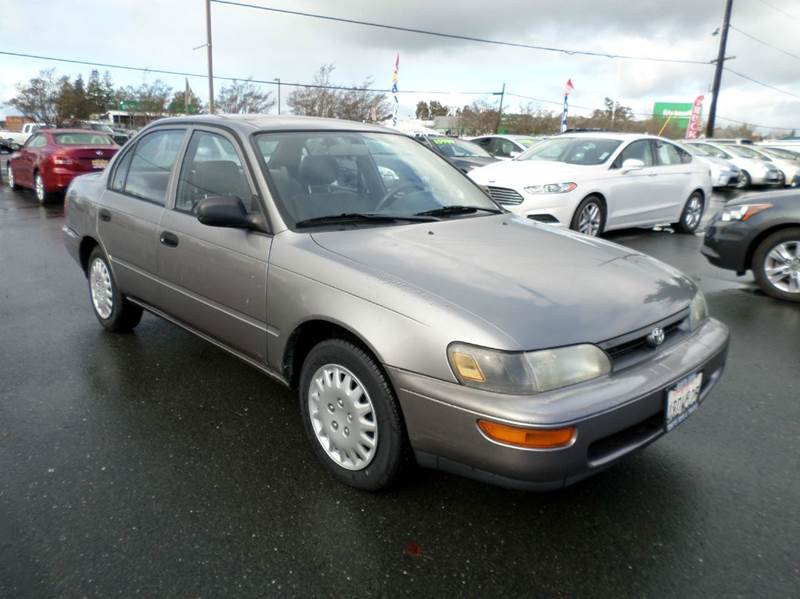 1995 TOYOTA COROLLA BASE 4DR SEDAN gray new tires only 107841 miles 3-speed automatic transm