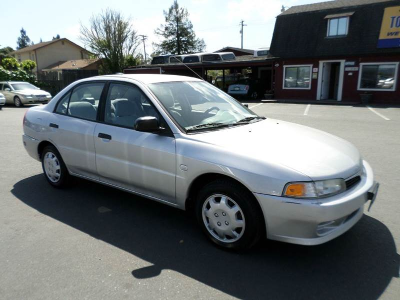2001 MITSUBISHI MIRAGE ES 4DR SEDAN silver 5sp2433 mpg  new tires center conso