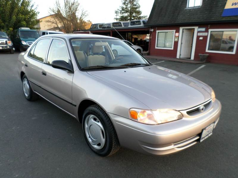 2000 TOYOTA COROLLA CE 4DR SEDAN gold new tiresone owner vehicle cassette center cons