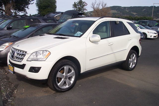 2009 MERCEDES-BENZ M-CLASS ML350 4MATIC white 4wdawdabs brakesair conditioningalloy wheelsam