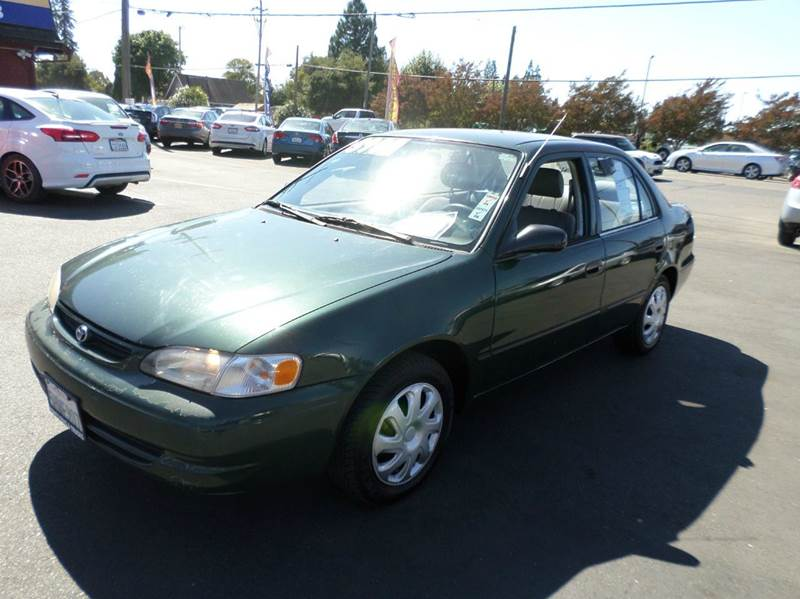 2000 TOYOTA COROLLA VE 4DR SEDAN green new tirestiming chain not belt center console front a