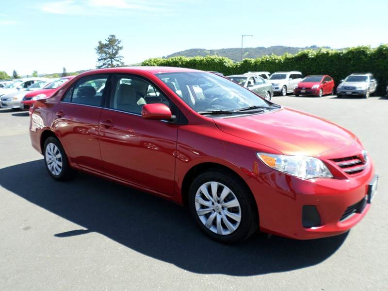 2013 TOYOTA COROLLA LE 4DR SEDAN 4A red one owner vehicle new tires always service