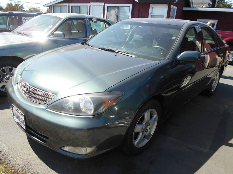 2002 TOYOTA CAMRY SE 4DR SEDAN green one owner vehicle lots of records reported on car-fax a