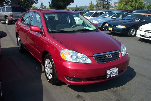 2005 TOYOTA COROLLA LE 4DR SEDAN red center console - front console with storage clock daytime