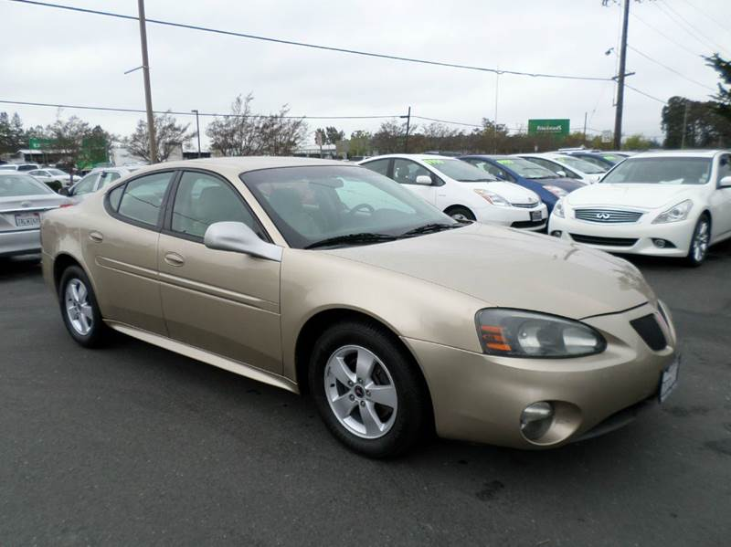 2005 PONTIAC GRAND PRIX BASE 4DR SEDAN gold anti-theft system - alarm center console - front con
