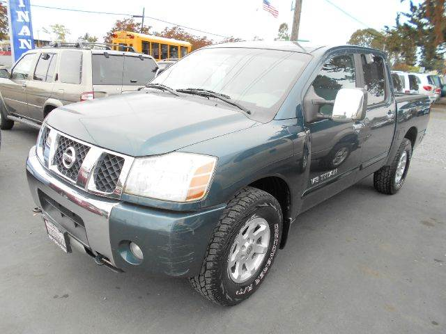 2005 NISSAN TITAN SE 4DR CREW CAB 4WD SB green one owner pick up truck 17 inch wheels 56l f