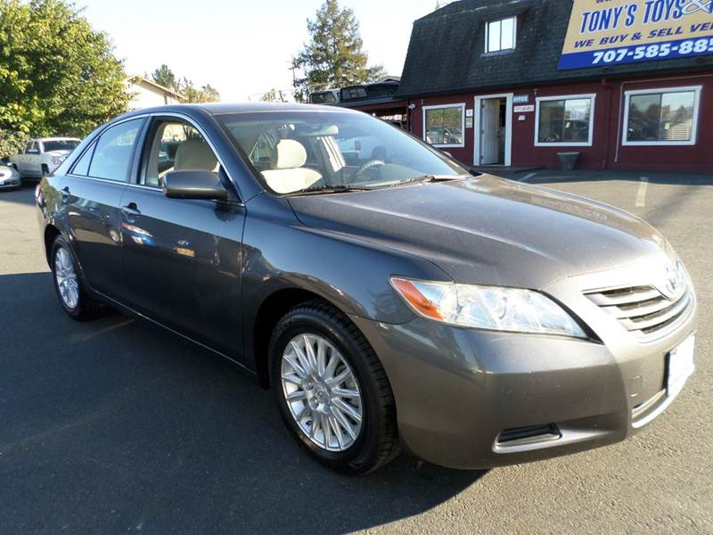 2007 TOYOTA CAMRY LE 4DR SEDAN 24L I4 5A gray one owner vehicle new tires 2-stage unlock