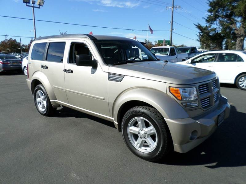 2010 DODGE NITRO SXT 4X4 4DR SUV gold 4x4 suv 2-stage unlocking doors 4wd selector - elect