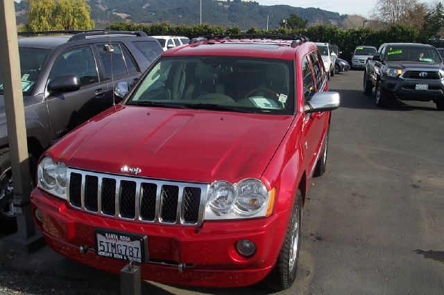 2006 JEEP GRAND CHEROKEE OVERLAND 4WD red 4wdawdabs brakesadjustable foot pedalsair conditioni