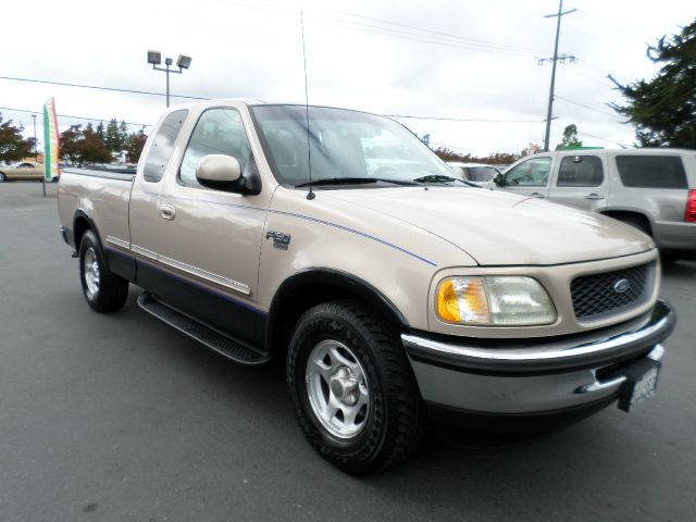 1998 FORD F-150 LARIAT 3DR EXTENDED CAB SB gold abs - 4-wheel bumper color - chrome exterior ent