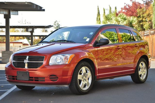 2009 DODGE CALIBER SXT 4DR WAGON orange we finance everybody  having trouble financing a car w