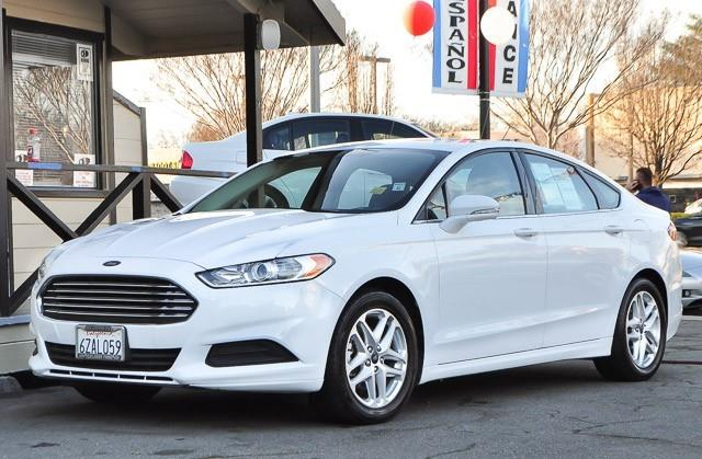 2013 FORD FUSION SE 4DR SEDAN white contact los amigos auto sales today for information on dozens