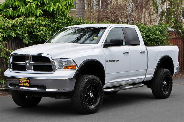 2011 RAM RAM PICKUP 1500 SLT 4X4 4DR QUAD CAB 63 FT SB white we finance everybody  having trou