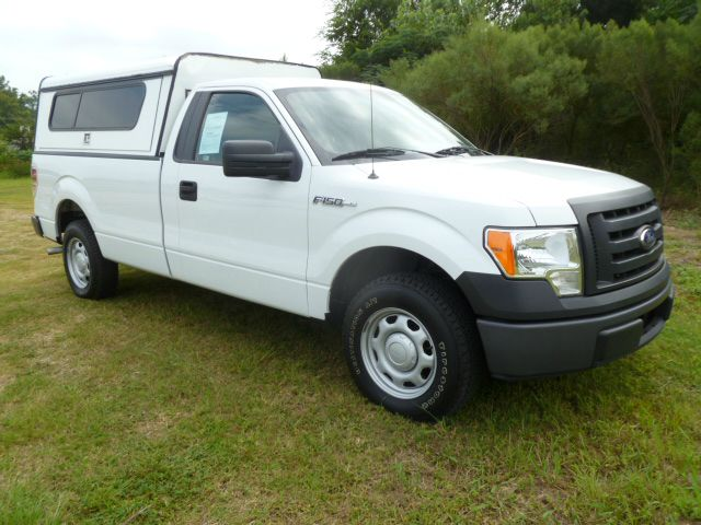 2010 FORD F150 XL 8-FT BED 2WD white this truck with a ctc cargo top with interior shelves will k