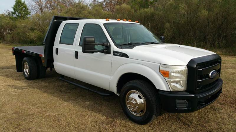 2011 FORD F-350 XL CREW CAB FLAT BED SD 2WD 85 FLAT BED white this truck is definitely a rare fi